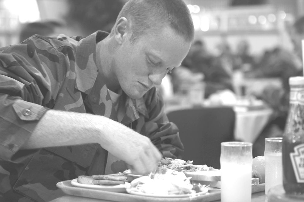 Soldier eating in mess hall