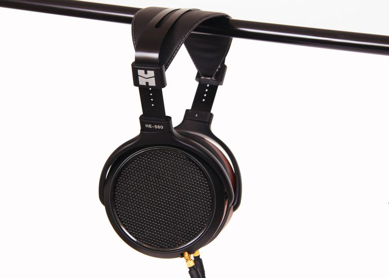 The HiFiMan HE-560 planar magnetic headphones hanging off a metal bar