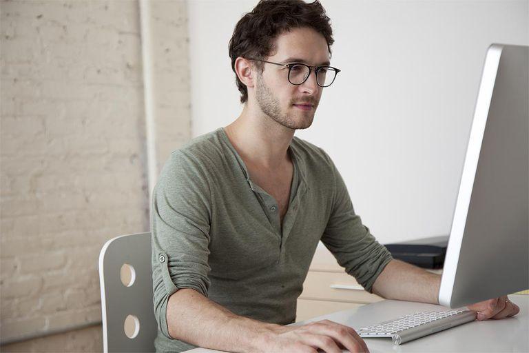 Caucasian man working at computer
