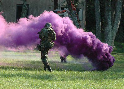 This is a purple smoke grenade, used during a military training exercise.