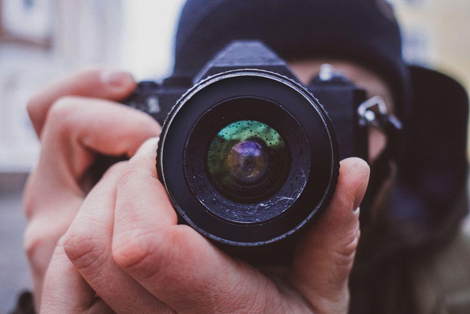Close-Up Of Man Photographing Through Dslr