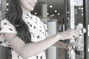 Retail employee opening store