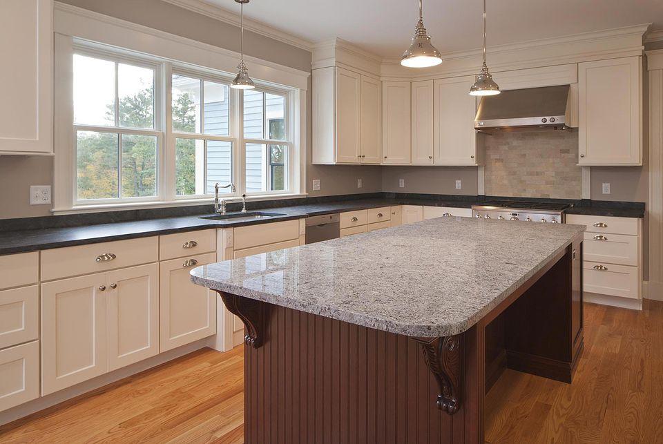 Custom kitchen with granite slab.