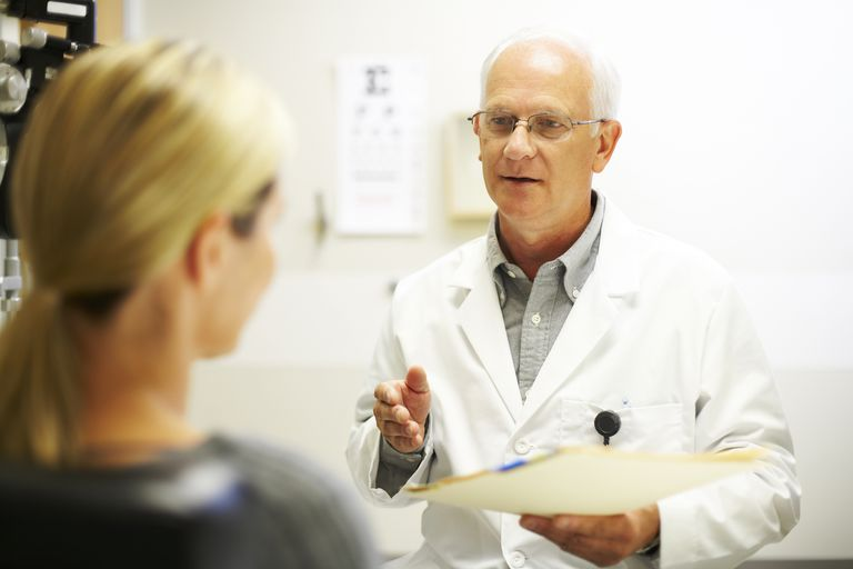 Mature doctor having a discussion with patient