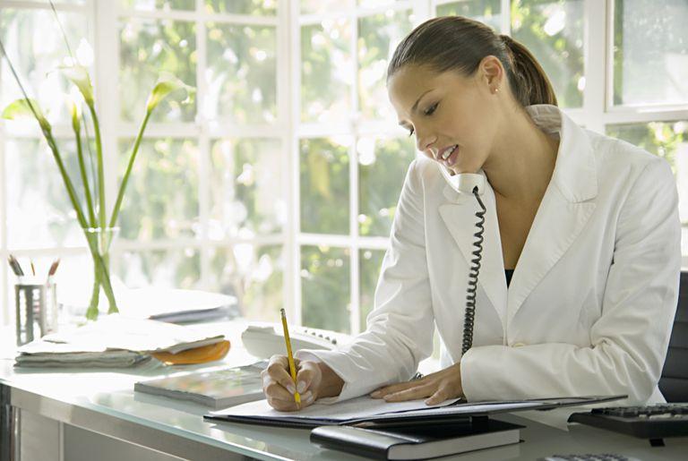 Secretary on phone taking notes