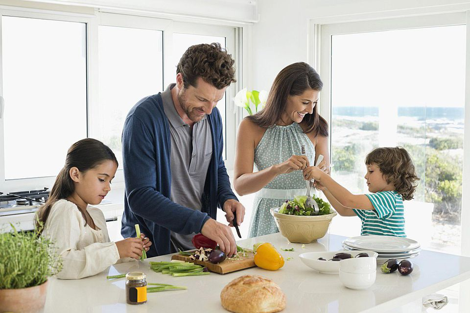 A picture of a family cooking together
