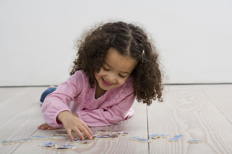 Child Doing Jigsaw Puzzle