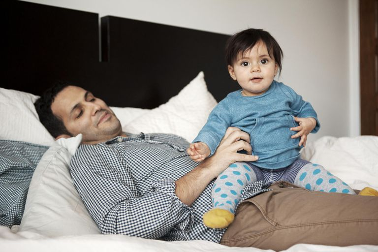 Father with baby girl on lap