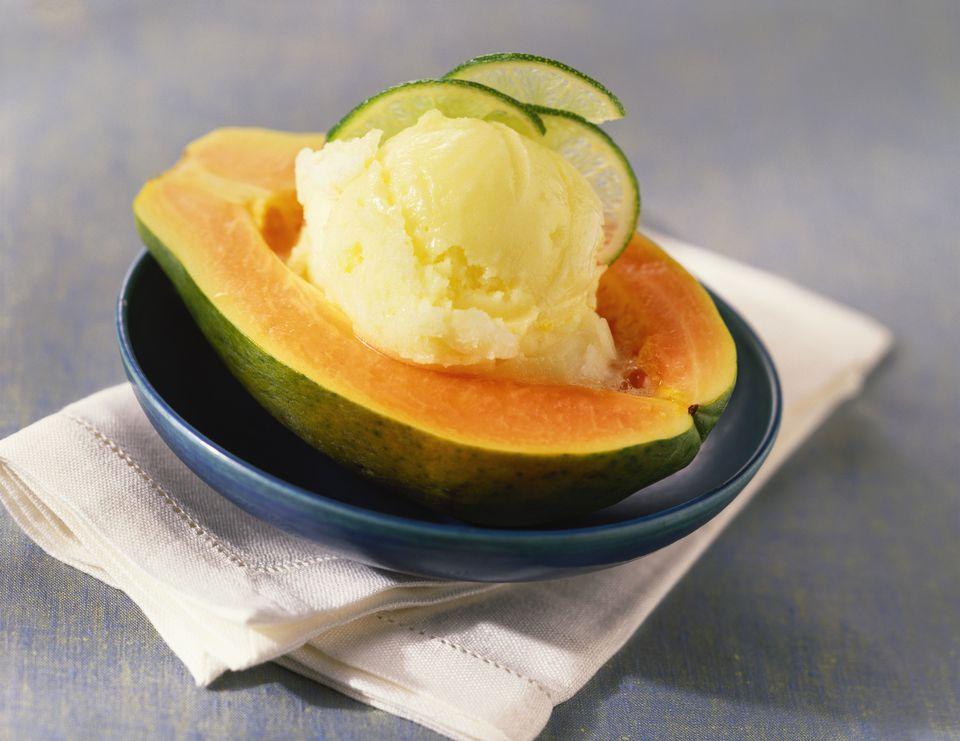 Papaya ice cream inside papaya half