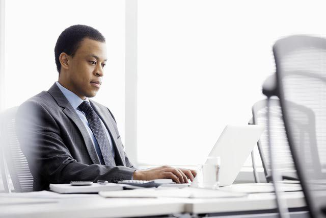 Businessman working at a laptop in a conference room
