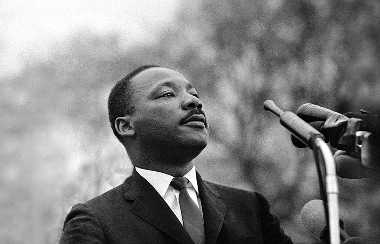 Dr. Martin Luther King, Jr. speaking before crowd of 25,000 Selma To Montgomery, Alabama civil rights marchers, 1965