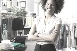 Female salesperson in clothing store