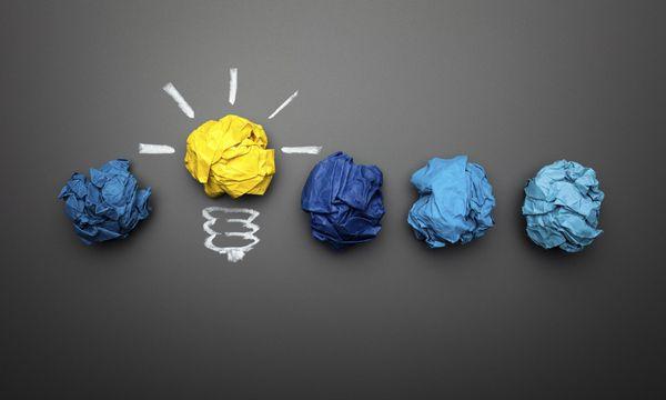 Light bulb crumpled paper on blackboard - Idea Concept Background