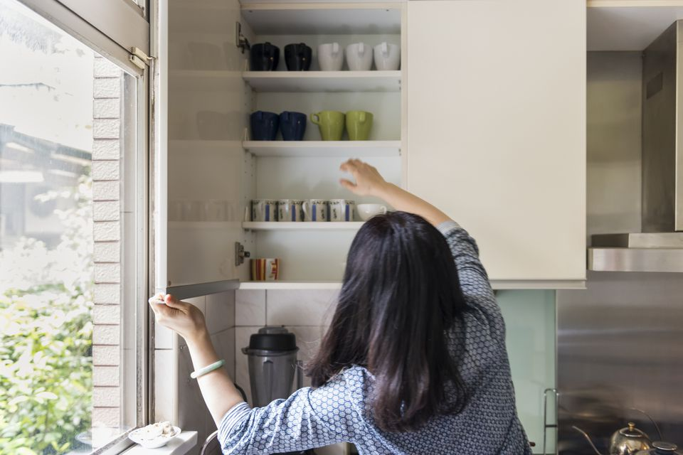 Woman at the Kitchen Shelves