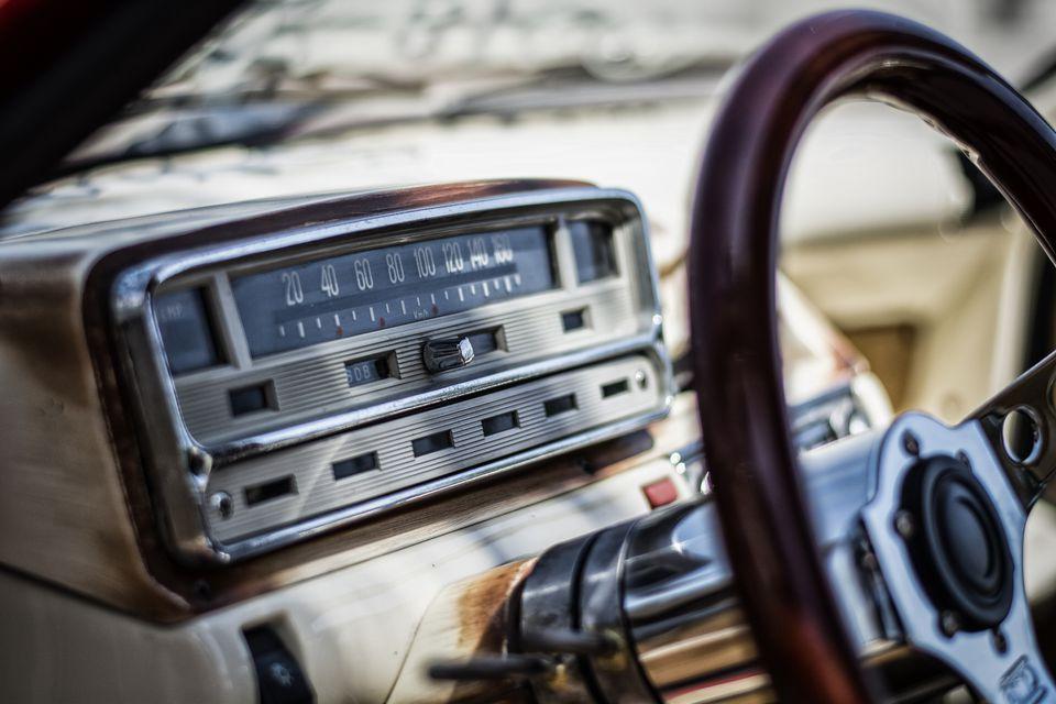 Close-Up Of Radio On Car Dashboard