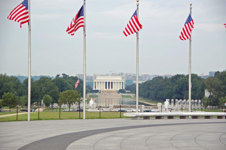 National Park Service photo, Lincoln Memorial through flags at Washington Monument