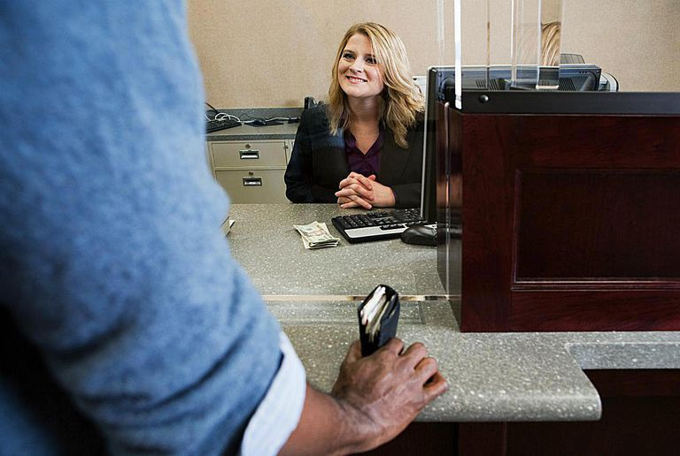 Bank teller working in bank