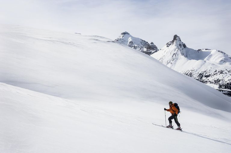 Man back country skiing on Parker Ridge, Banff National Park, Alberta Canada