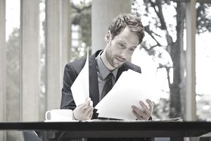 Businessman reading documents at desk