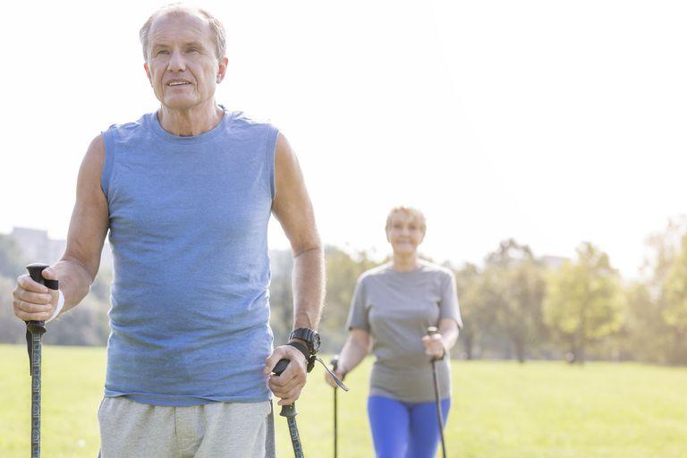 Senior Couple Exercising With Walking Poles