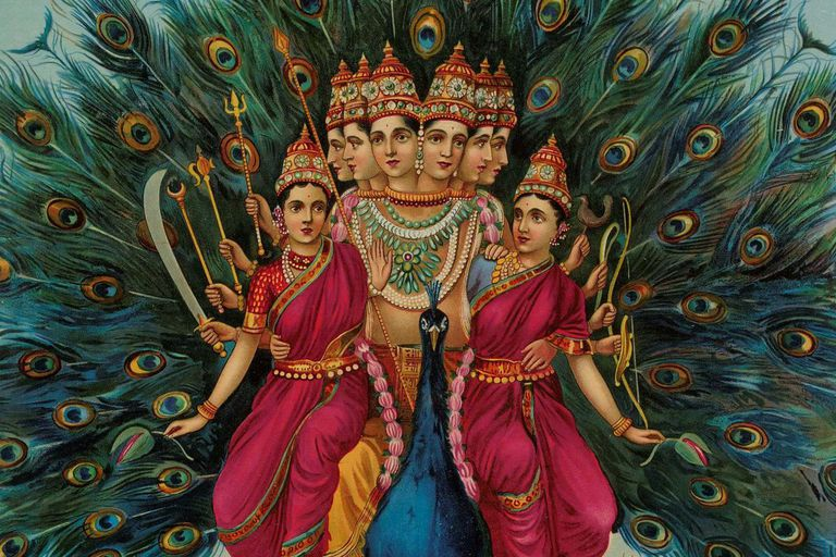 Sri Shanmukaha Subramania Swami/Hindu deity Karktikeya or Murugan with his consorts on his Vahana peacock.