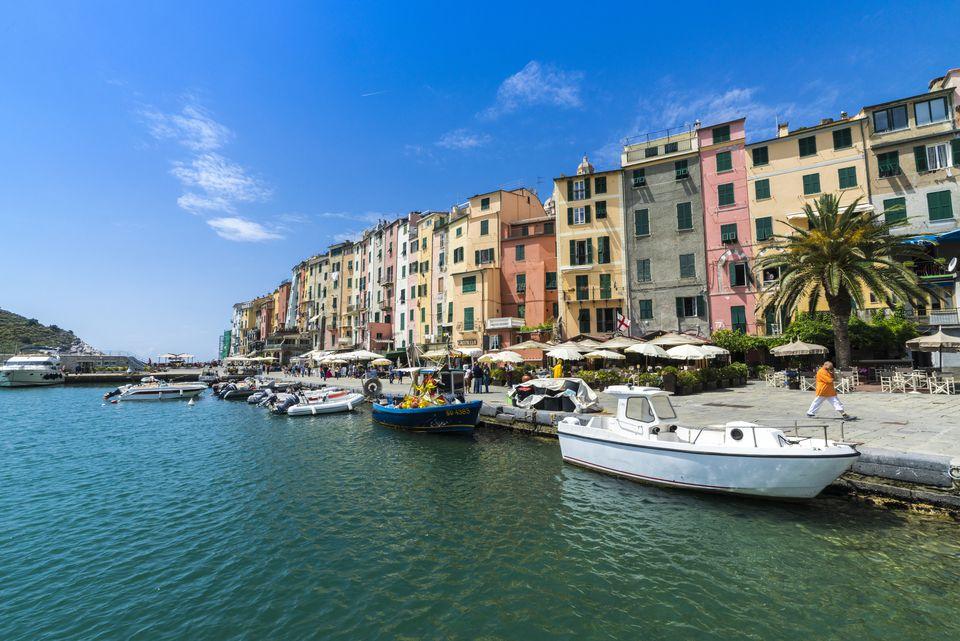 The turquoise sea frames the typical colored houses of Portovenere, UNESCO World Heritage Site, La Spezia province, Liguria, Italy, Europe