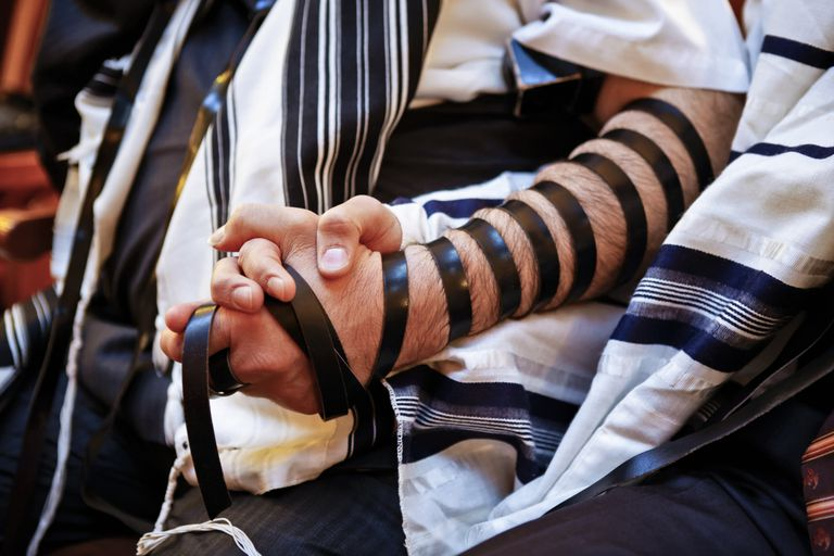 A man wearing Tefillin, one of the 613 mitzvot
