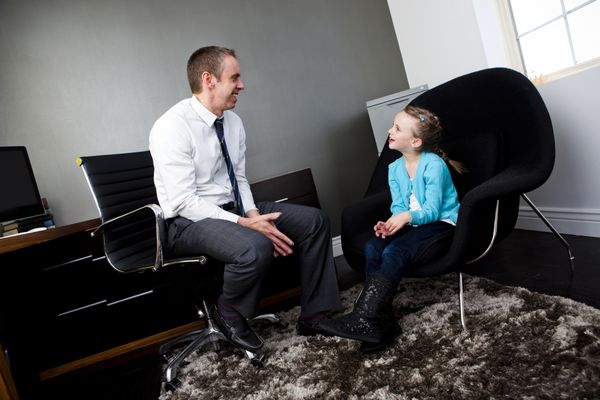 Child Psychologist talking to child before IQ testing
