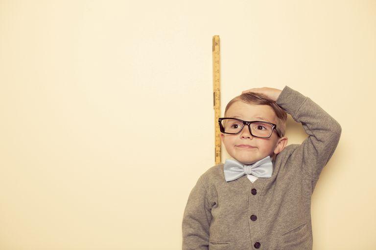 short boy being measured