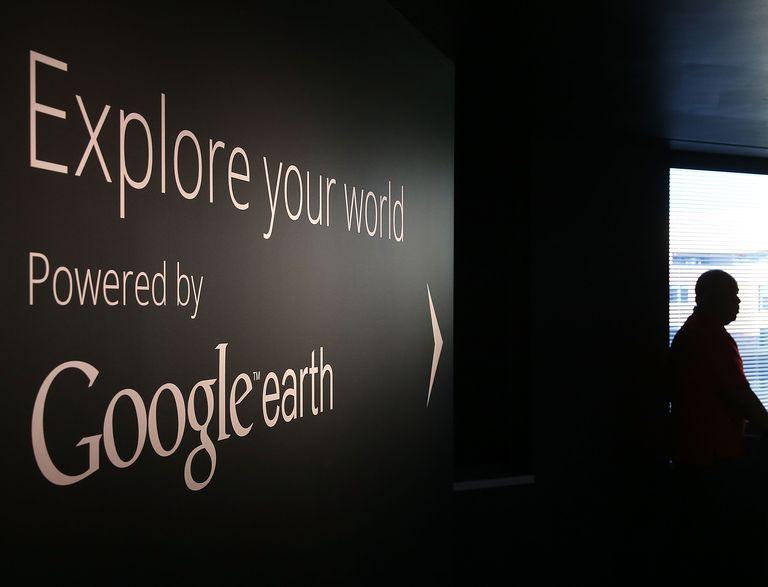 A man stands near a Google Earth exhibit at Google's Washington headquarters,