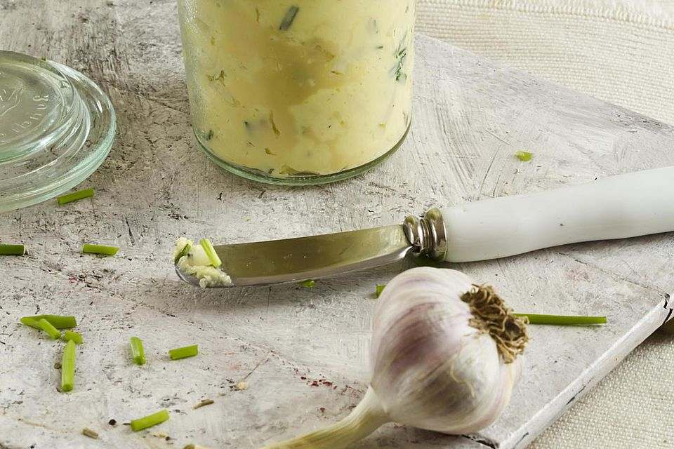 Garlic with herb and butter on a chopping board