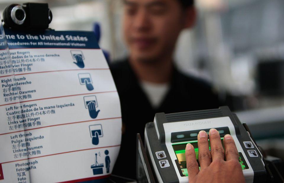 Fingerprint scanner at customs checkpoint
