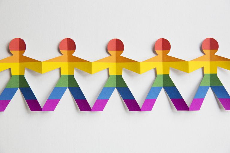 Paper cut-out figures in gay flag colours