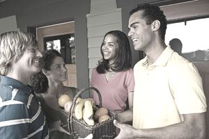 Friendly neighbors giving fruit basket