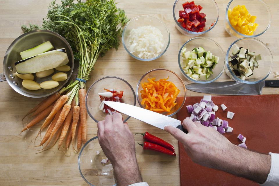 Chefs knife cutting vegetables