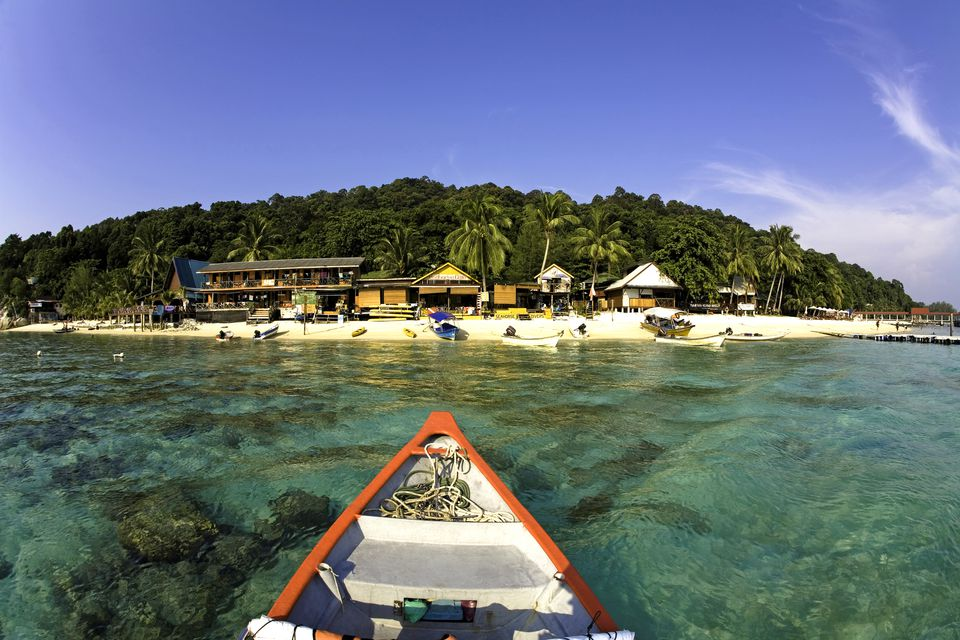 A boat arrives at Perhentian Besar, an island in Malaysia