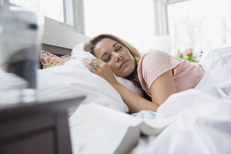 Serene woman sleeping in bed
