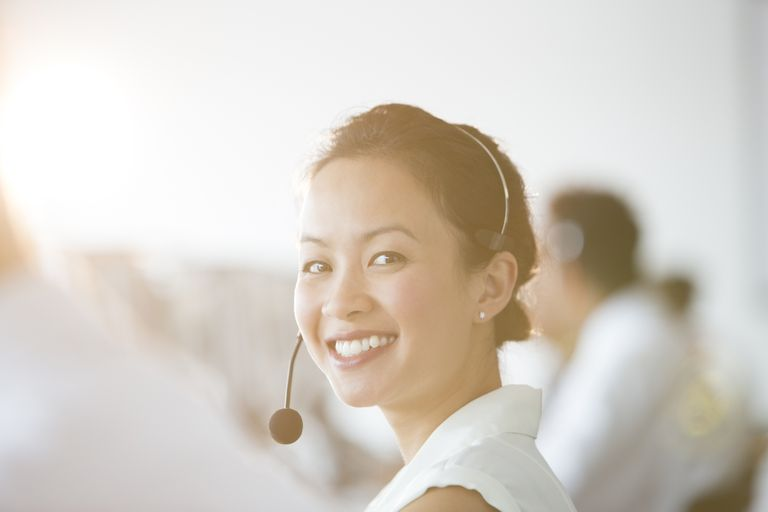 Asian Businesswoman wearing headset in office