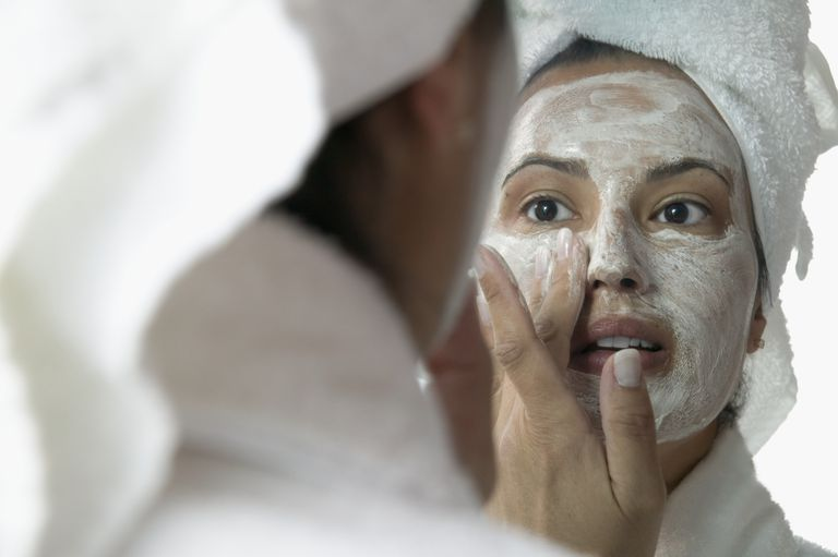 Woman applying face masks