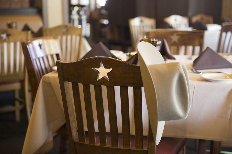 Cowboy hat at table.