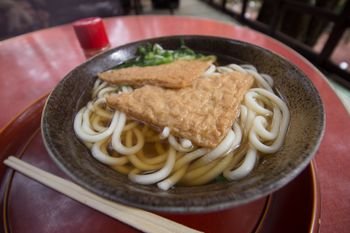 Japanese Kitsune Udon Noodles In Hot Soup With Seasoned Aburaage