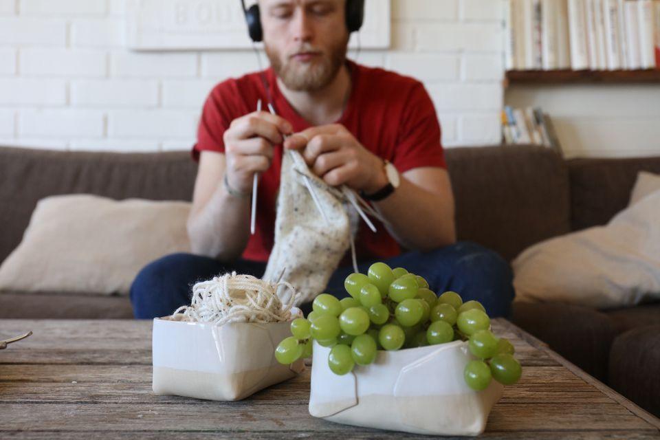 Man Knitting At Home