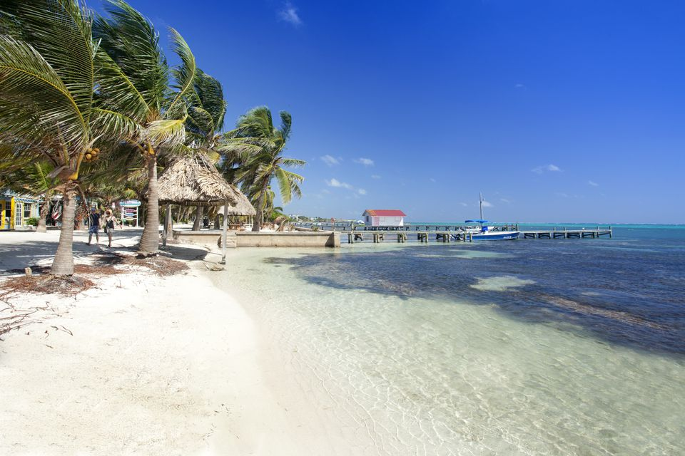 Belize, Ambergris Caye, San Pedro, beach and Barrier Reef drive in San Pedro, Red hut on jetty and turquoise Caribbean sea